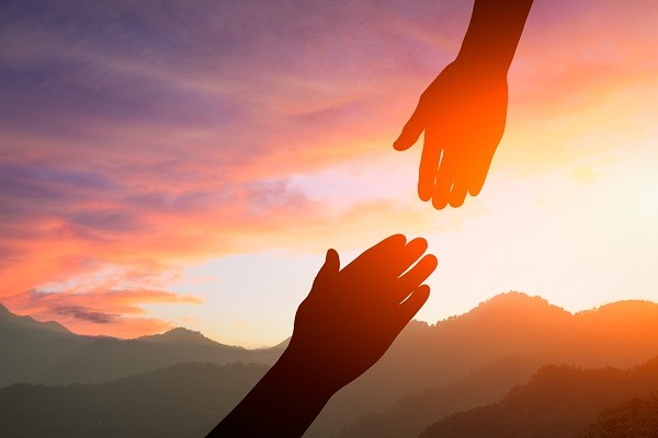 helping hand with the sky sunset background